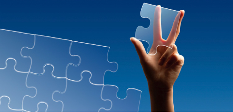 Hand holding transparent puzzle piece
